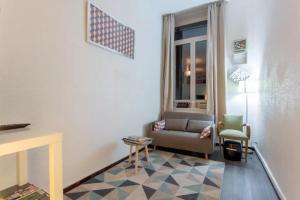 A seating area at Apartment Pierre Scize Sur La Saône