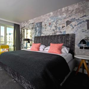 A bed or beds in a room at Malmaison Brighton