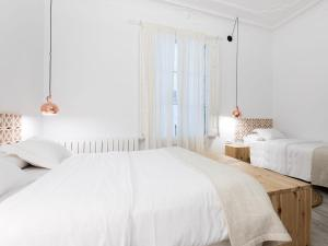 A bed or beds in a room at Bruc & Bruc