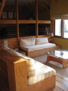 A bed or beds in a room at Cabaña Yelcho en la Patagonia