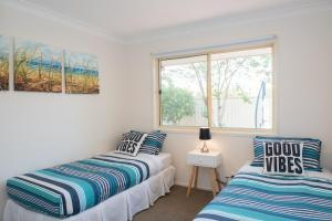 A bed or beds in a room at Gold Coast Theme Park Family Villa