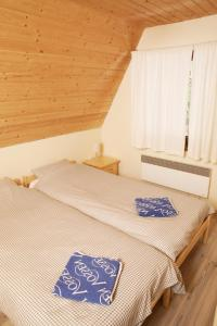 A bed or beds in a room at Ski Jasna Chalet