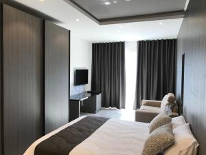 A bed or beds in a room at Hub apartment