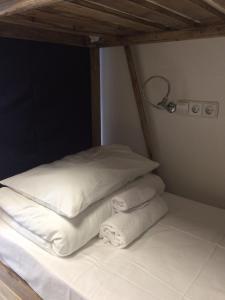 Кровать или кровати в номере Hostel 65