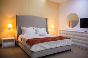 A bed or beds in a room at Santa Quaranta Premium Resort
