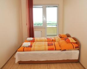 A bed or beds in a room at Tisza Palota Apartmanok