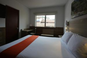 A bed or beds in a room at Casa Andina Standard Cusco Plaza