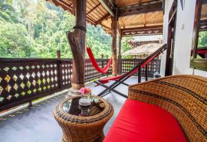 A balcony or terrace at EcoTravel Cottages Bukit Lawang