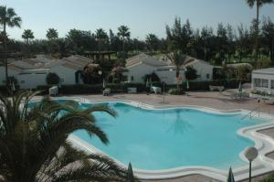 A view of the pool at Bungalows Campo Golf or nearby