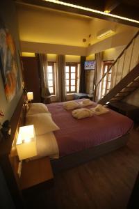 Ένα ή περισσότερα κρεβάτια σε δωμάτιο στο 11City Rooms