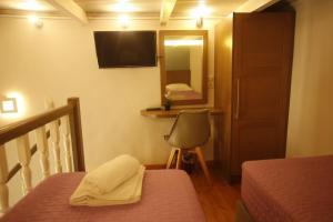 Μια τηλεόραση ή/και κέντρο ψυχαγωγίας στο 11City Rooms