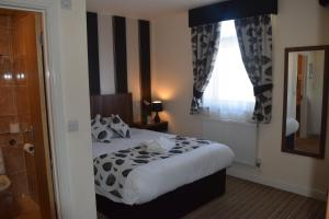 A bed or beds in a room at Star Anglia Hotel