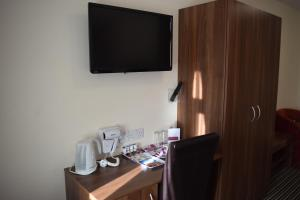 A television and/or entertainment center at Star Anglia Hotel