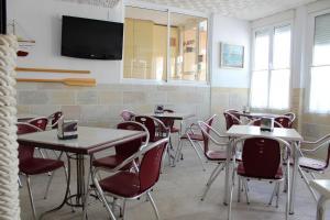 Una cocina o zona de cocina en Hostal Masin