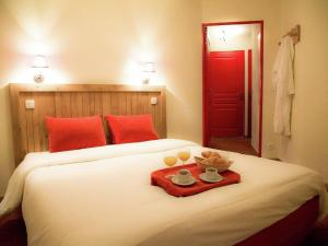 A bed or beds in a room at Apartment Les Alpages De Val Cenis 2