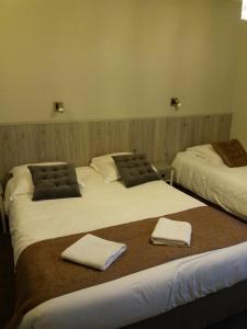 Un ou plusieurs lits dans un hébergement de l'établissement Larmor Plage Hotel