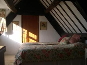A bed or beds in a room at 189 April Cottage
