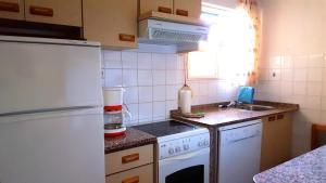 Een keuken of kitchenette bij Bungalows Peikert - 40b