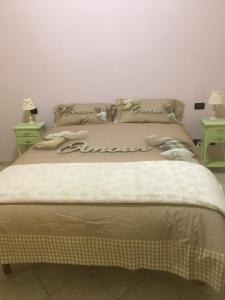 A bed or beds in a room at Il Nido