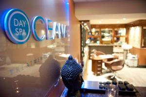 A restaurant or other place to eat at Ocean Beach Hotel & Spa - OCEANA COLLECTION