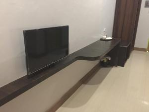 A television and/or entertainment center at LEUX Hotel