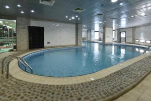 The swimming pool at or near Awaliv International Hotel