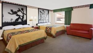 A bed or beds in a room at Super 8 by Wyndham Yucca Val/Joshua Tree Nat Pk Area