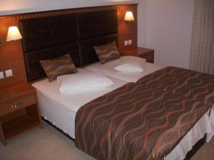 Кровать или кровати в номере Hotel Filoxenia