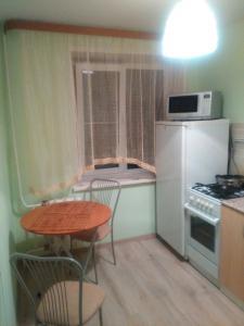 Кухня или мини-кухня в Apartment on Sovetskaya 24