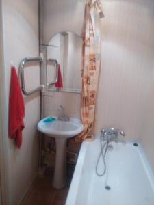 Ванная комната в Apartment on Sovetskaya 24
