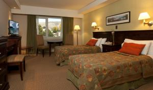 A bed or beds in a room at Hotel Quijote