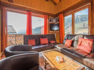 A seating area at Cozy Holiday Home in Les Gets near Ski Area