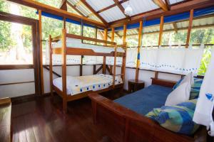 A bunk bed or bunk beds in a room at Saladero Ecolodge