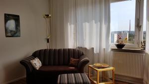 Ein Sitzbereich in der Unterkunft Messe Apartment Nürnberg