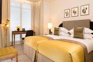 Lova arba lovos apgyvendinimo įstaigoje Le Tsuba Hotel
