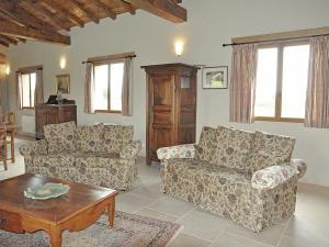A seating area at Quaint Villa in Bourrouillan with Private Terrace