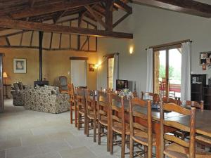 A restaurant or other place to eat at Quaint Villa in Bourrouillan with Private Terrace