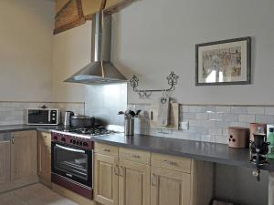 A kitchen or kitchenette at Quaint Villa in Bourrouillan with Private Terrace