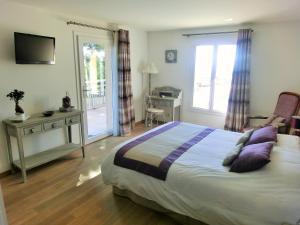Un ou plusieurs lits dans un hébergement de l'établissement Villa Azur Golf