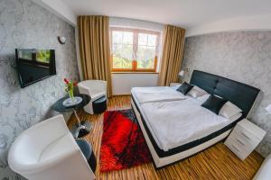 Posteľ alebo postele v izbe v ubytovaní Penzion Panda