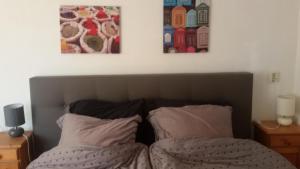 Een bed of bedden in een kamer bij B&B Meerland