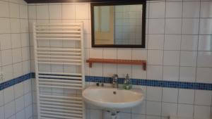 Een badkamer bij B&B Meerland