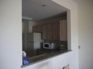 A kitchen or kitchenette at Aquarius Beach Tower