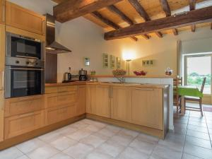 A kitchen or kitchenette at Charming Holiday Home in Les Brouzils with Swimming Pool