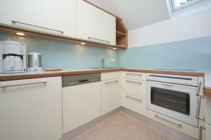 Küche/Küchenzeile in der Unterkunft Pension Seevilla Annelies