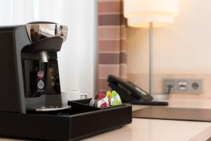 Coffee and tea making facilities at Mercure Hotel Düsseldorf Süd