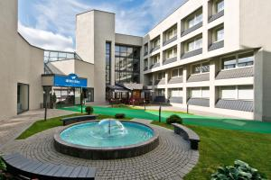 The swimming pool at or near AirInn Vilnius Hotel