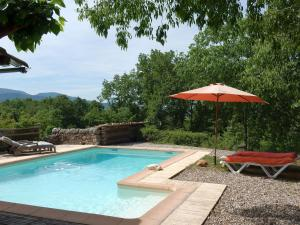 The swimming pool at or near Cozy Holiday Home in Saint-Alban-Auriolles with Private Pool