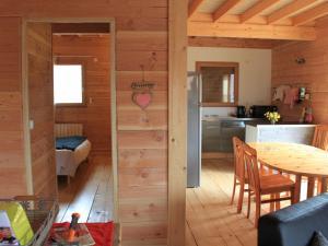 A kitchen or kitchenette at Sunlit Chalet near Ski Area in Gerardmer