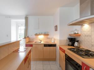 A kitchen or kitchenette at Spacious Holiday Home in Lanrelas with Garden